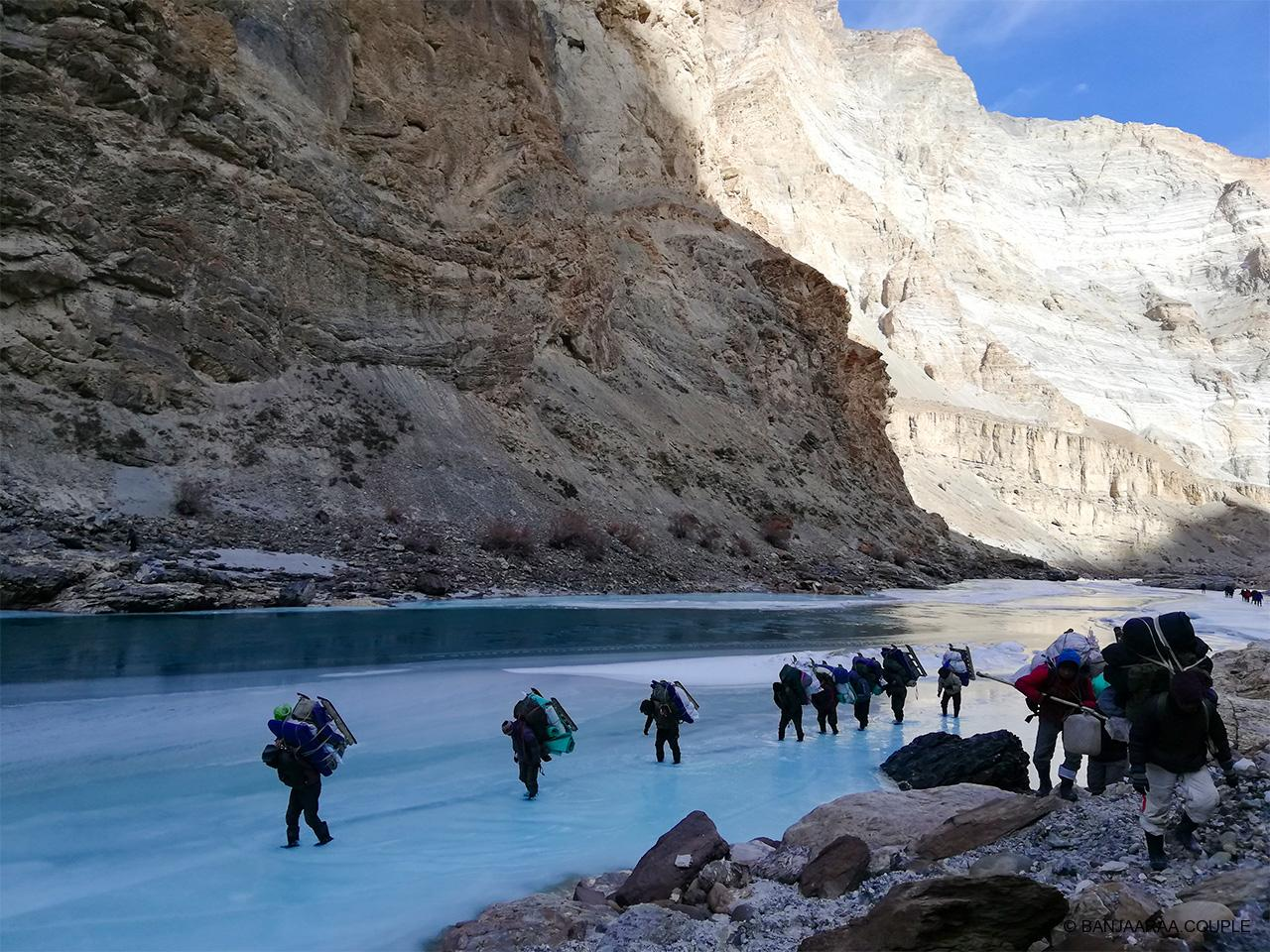 A walk on the frozen river - porters carrying the essentials