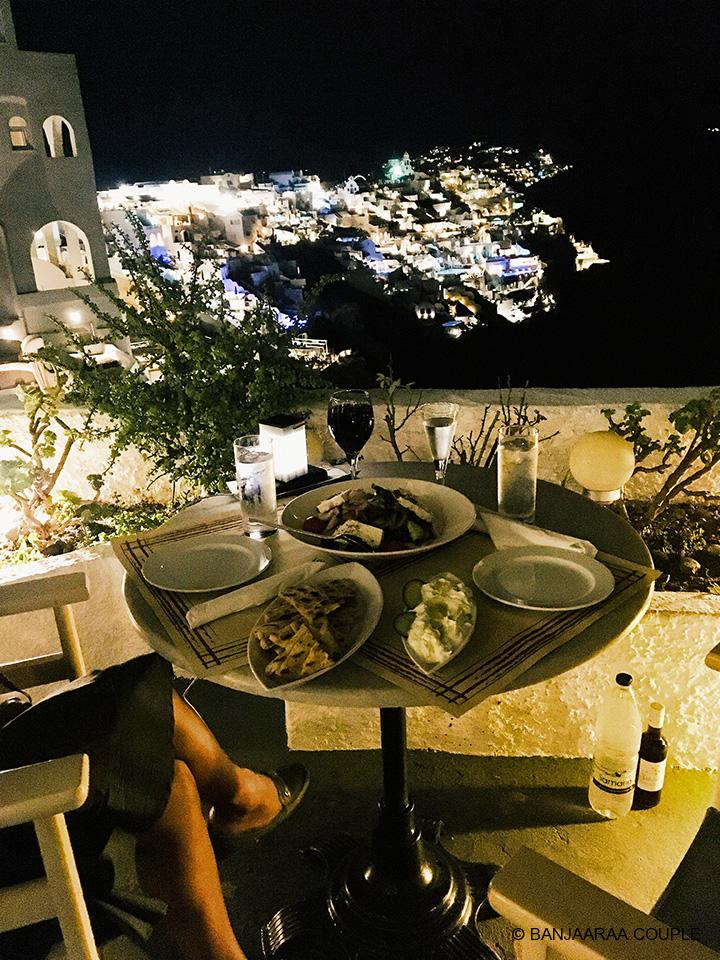 Our dinner at 218 Degrees. At the back is the lit up Oia.