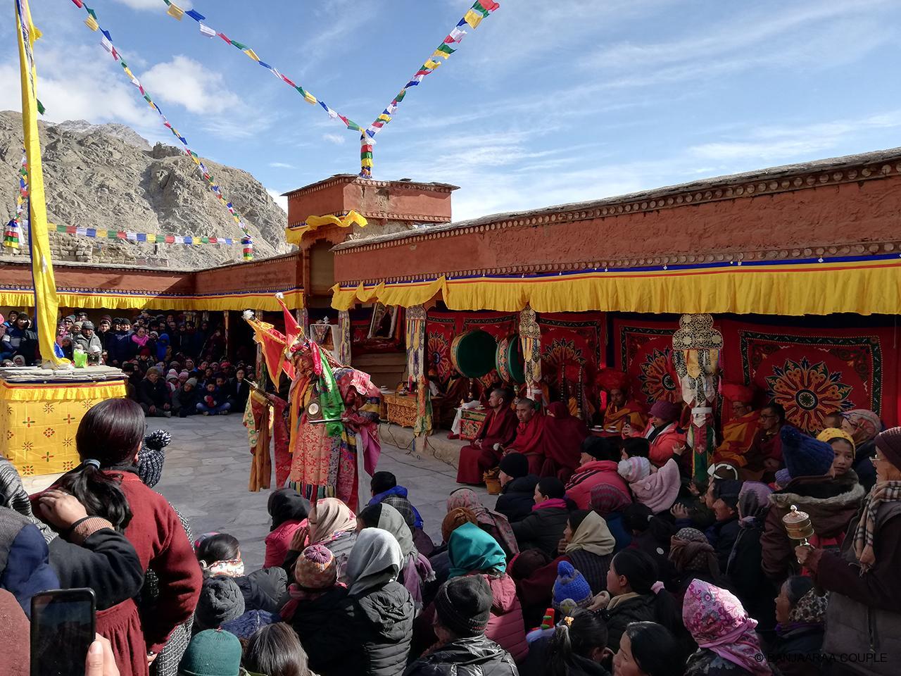 A monk dancing in the festival wearing full attire