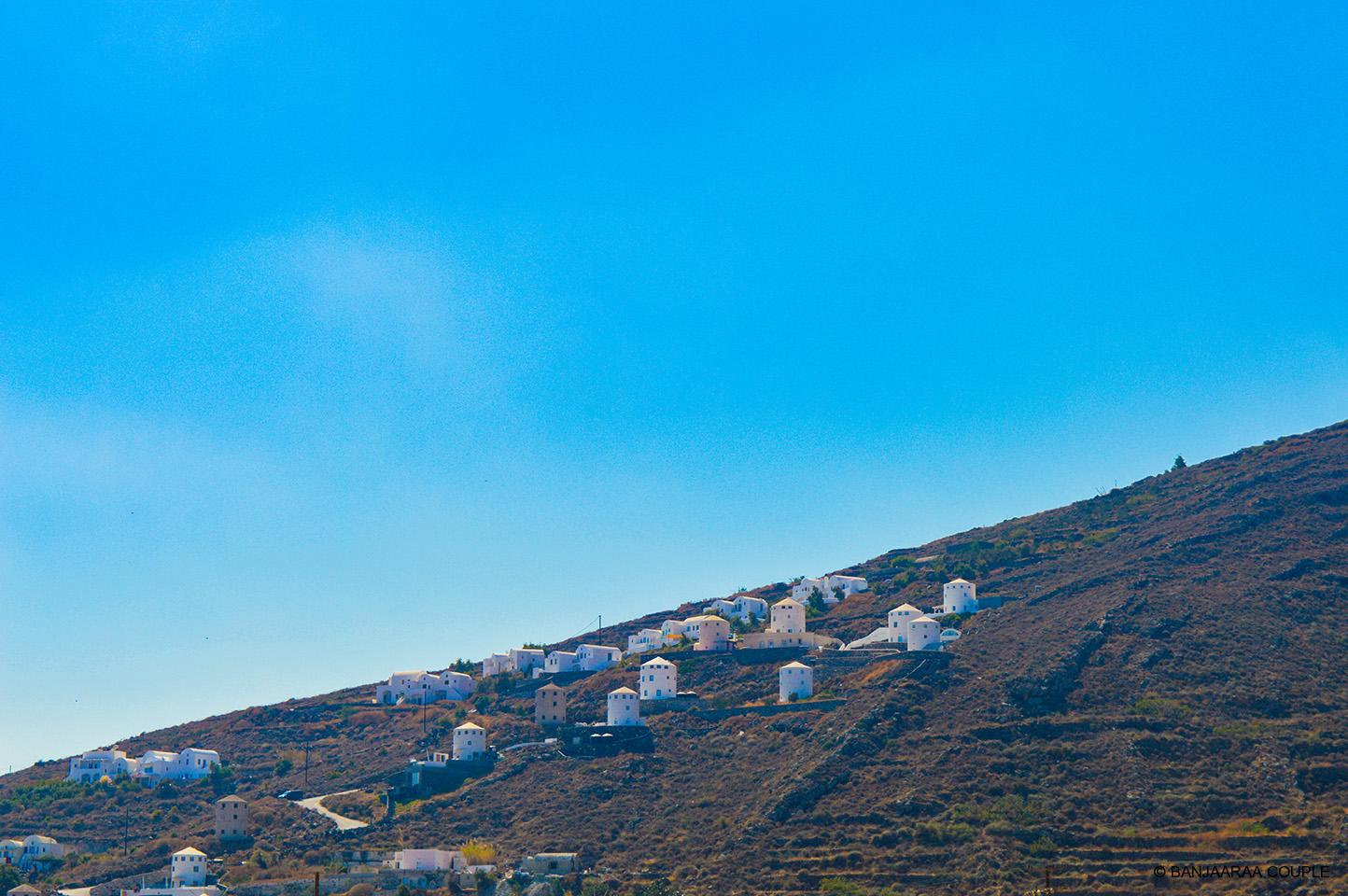 White washed houses strewn all over the landscape of Santorini