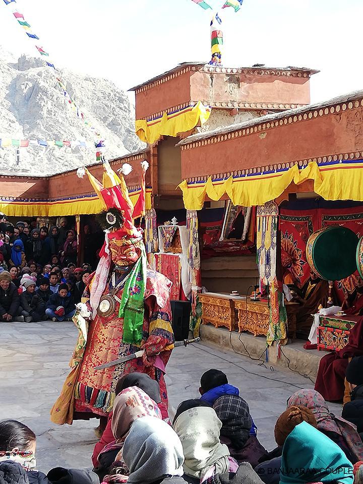 Crowd cheering the dancing monk