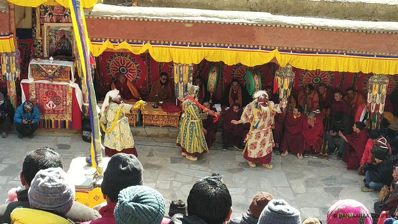 3 monks performing the sacred dance in the festival