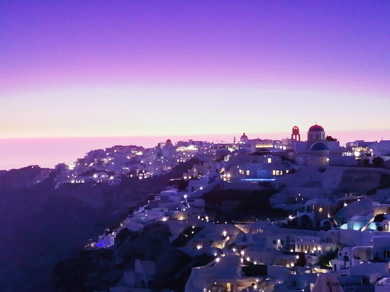 Oia beginning to lit up just at dusk