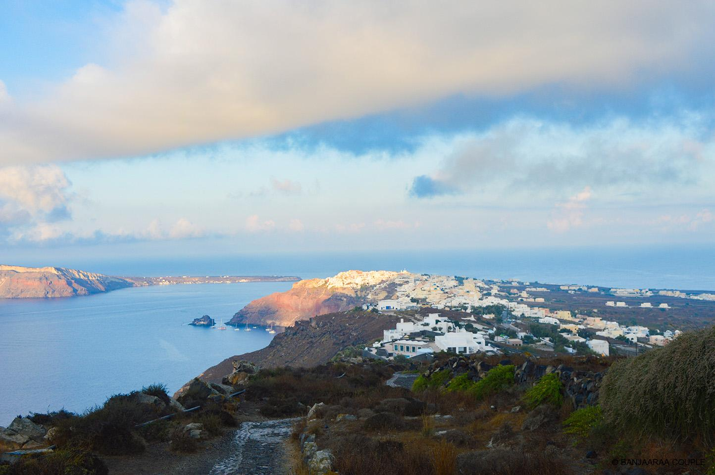 The city of Oia glistening with first rays of Sun