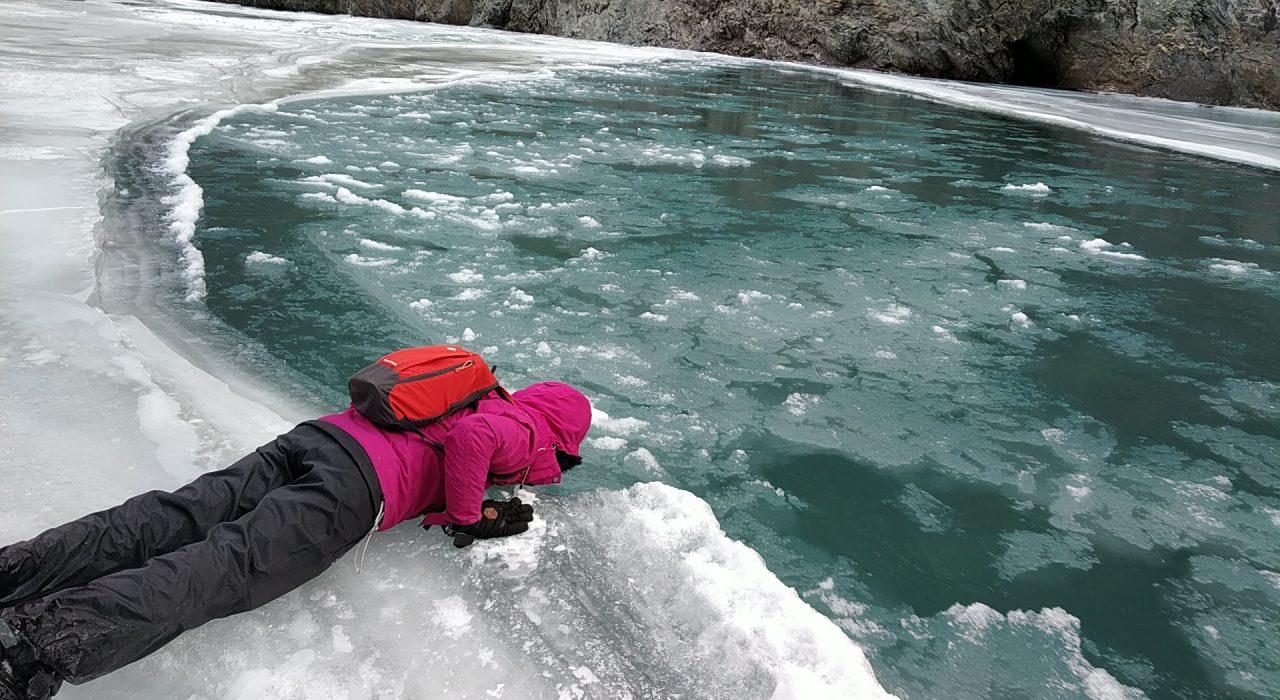 Drinking original ice slush right from the flowing Zanskar river