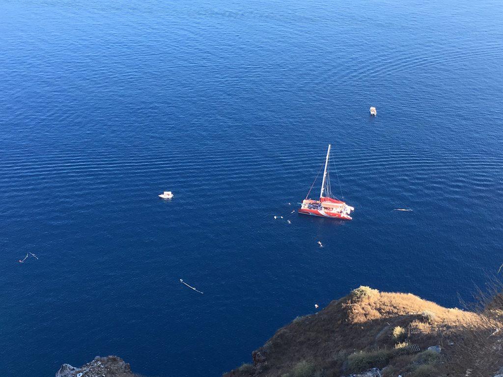 Passengers of a Catamaran enjoying there snorkelling session, Santorini