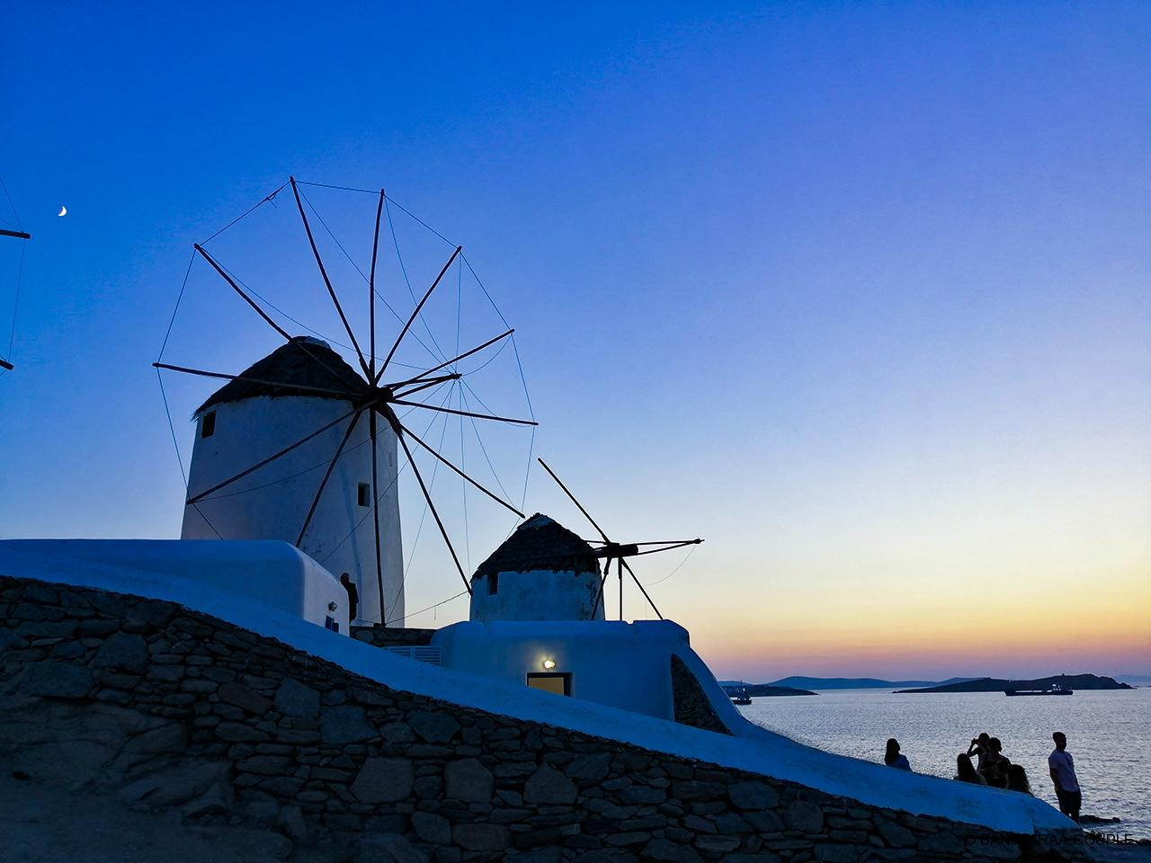 Windmills of Mykonos with beautiful sunset in the background